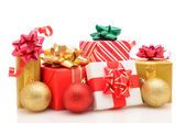 Christmas presents and ornaments on white — Stock Photo
