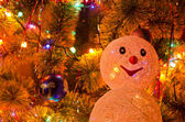 Christmas fur-tree with snowman — Stock Photo