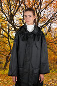 Woman in rain coat — Stock Photo