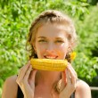 Woman eating corn-cob — Stock Photo #7408790