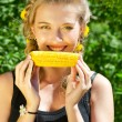 Woman eating corn-cob — Stock Photo #7593842
