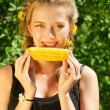 Woman eating corn-cob — Stock Photo #7856180
