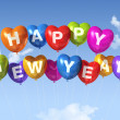 Happy new year heart shaped balloons — Stock Photo #7602230