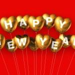 Gold happy new year heart shaped balloons — Stock Photo