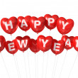 Stock Photo: Red happy new year heart shaped balloons