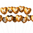 Foto Stock: Gold happy new year heart shaped balloons