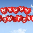 Happy new year heart shaped balloons — Stock Photo