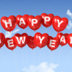 Happy new year heart shaped balloons — Stock Photo