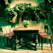 Stock Photo: Beautiful vintage wooden dining table with four chairs