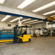 Factory wharehouse with forklift - Stock Photo