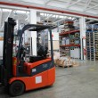 Factory wharehouse with forklift — Stock Photo