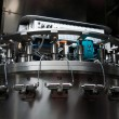 Italy wine: automatic bottling line - Stock Photo