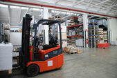 Factory wharehouse with forklift — Stok fotoğraf