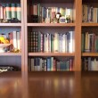 Stock Photo: Bookcase and table