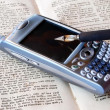 Cell phone, pen and old book — Stock Photo #7338384