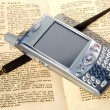 Cell phone, pen and old book — Stock Photo