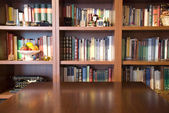Bookcase and table — Stock Photo