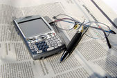 Cell phone, glasses and pen — Stock Photo