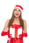 Christmas girl in red santa hat — Stock Photo