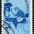 Stock Photo: Postage stamp US1960 Min wheelchair