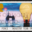 Stock Photo: Postage stamp GB 1986 North Seoil rig and light bulb