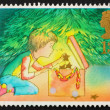 Postage stamp GB 1987 Decorating tree for Christmas — Stock Photo