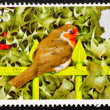 Postage stamp GB 1995 European Robin on fence rail — Stock Photo