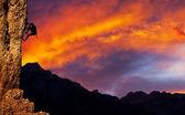 Climber on sunet — Stock Photo