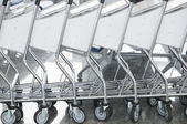 The row of luggage carts — Stock Photo