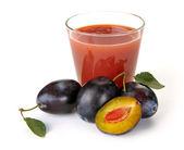 Plum juice and fruit — Stock Photo