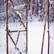 Broken fence under snow — Stock Photo
