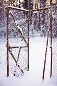 Broken fence under snow — Stock Photo