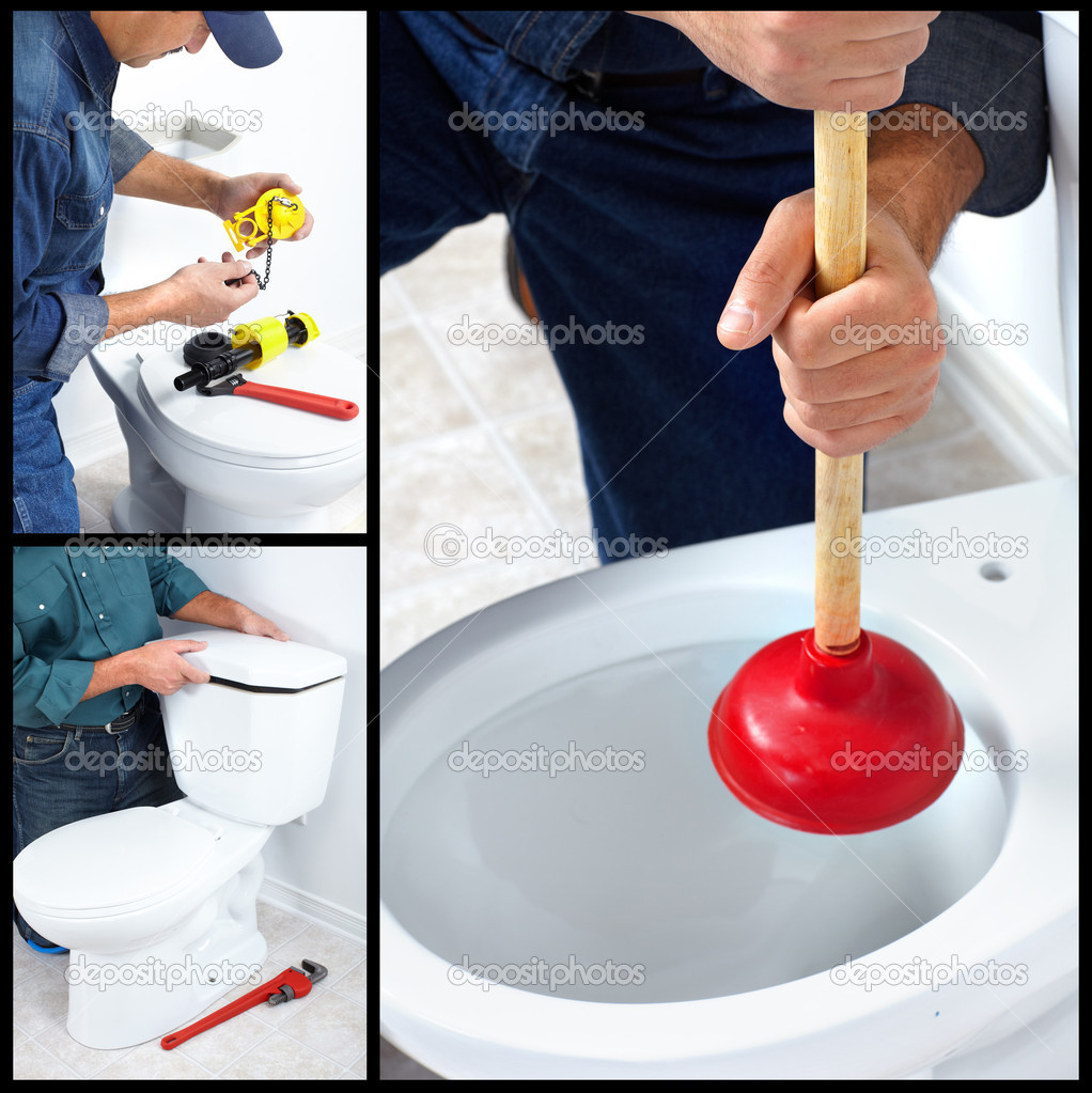 Plumber repairing a flush toilet. Plumber. Worker. — Stock Photo #6910543