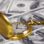 Clock and money — Stock Photo