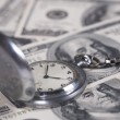 Silver clock and money — Stock Photo