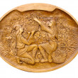 Photo: Gather grapes scene on wooden bass-relief isolated