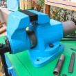 Old blue table mechanical vise clamp — Stock Photo