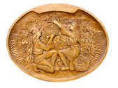 Gather grapes scene on a wooden bass-relief isolated — Stock Photo