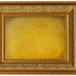 Vintage golden picture frame with empty parchment — Foto Stock #7587381