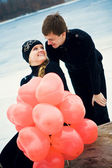 Couple in love with balls — Stock Photo