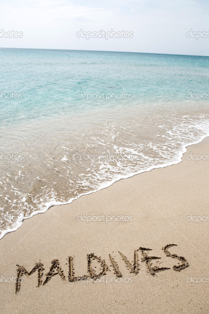 Maldives written on the sand  Stock Photo #7277084