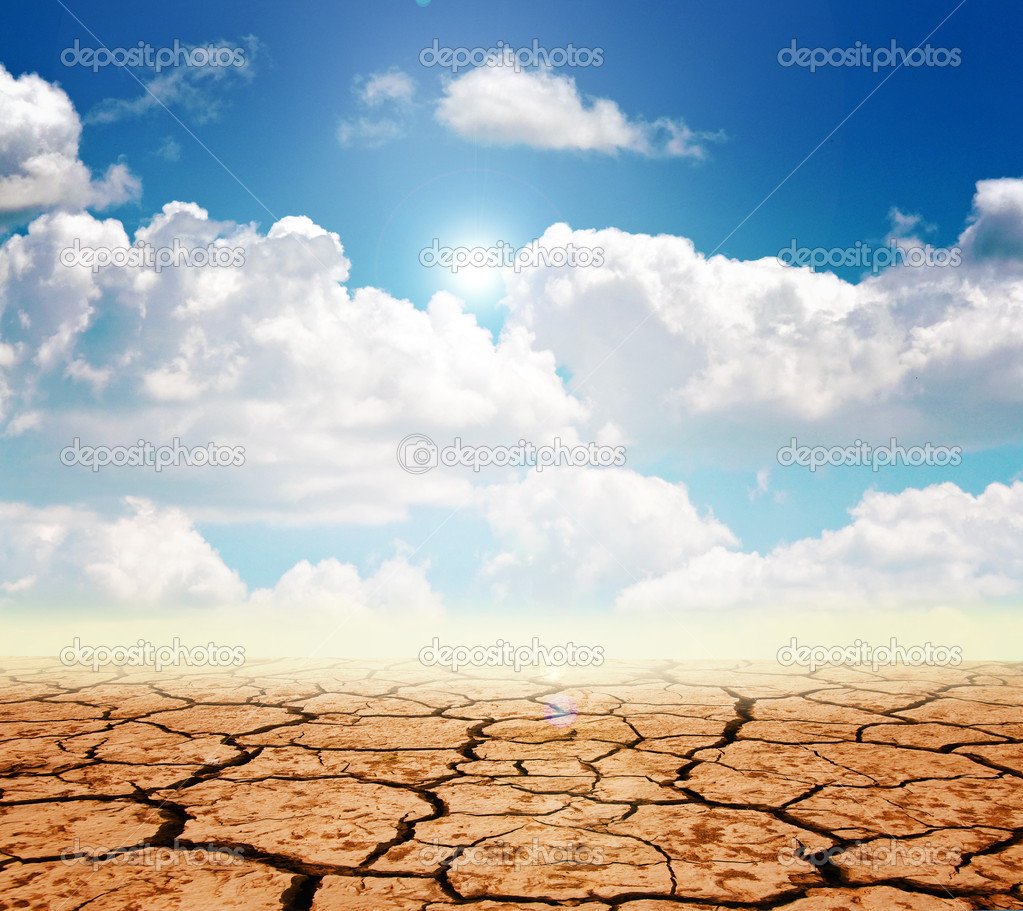 Drought land against a blue sky with clouds  Stock Photo #6945409