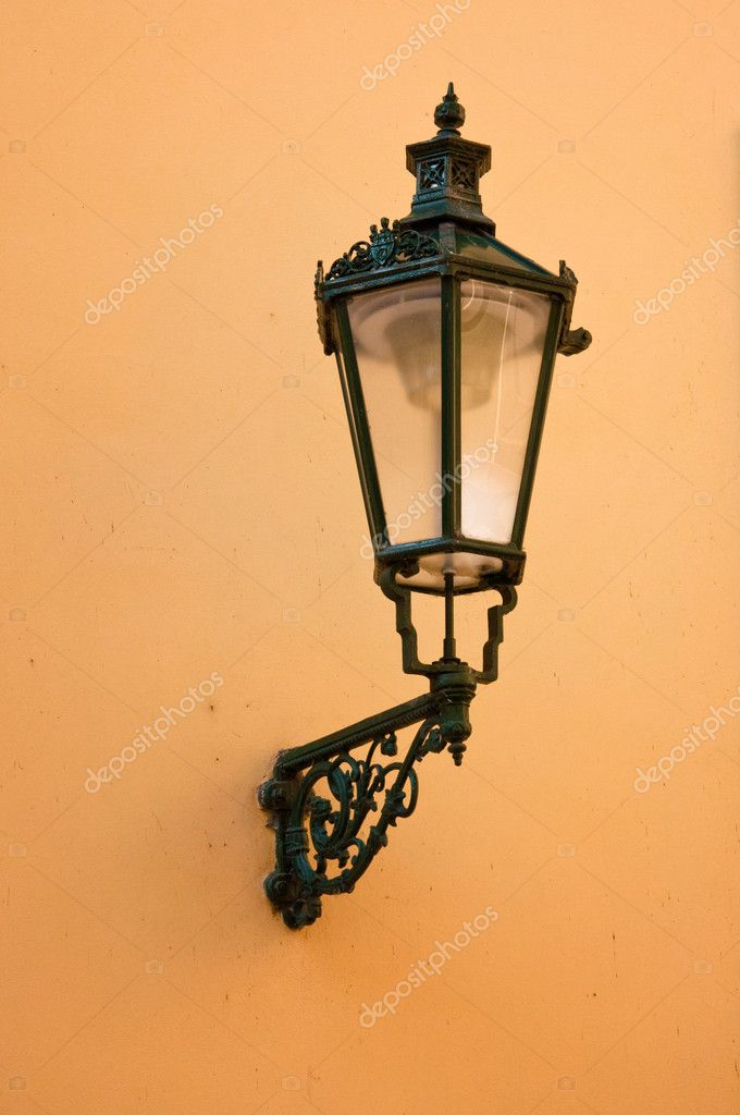 Wrought-iron lantern with its shadow on the yellow wall, Prague, Czech Republic  Stock Photo #7158622