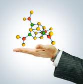 Molecule isolated on businessman hand — Stock Photo