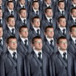 Many identical businessmen clones — Stock Photo #6840588