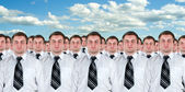 Many identical businessmen clones — Stock Photo