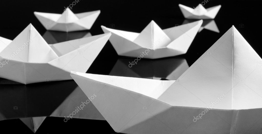 Many white paper boats in the dark  Stock Photo #6840916
