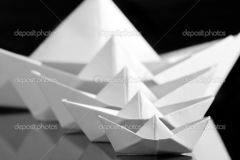 Many white paper boats in the dark — Stock Photo #6840946