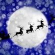 Santa against moon in snowfall — Stock Photo