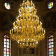 Chandelier in christian church - Stock Photo